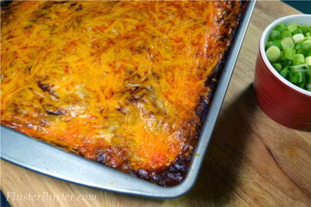 Simple Chicken Enchilada Casserole - seasoned chicken, layered between corn tortillas and cheese and then covered a flavorful sauce.