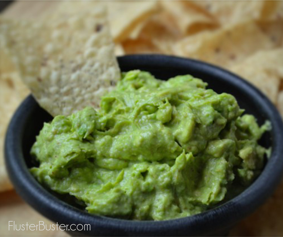 This Simple Guacamole Recipe is muy bien. In minutes, you'll have a fresh and flavorful topping for your favorite Mexican dish.