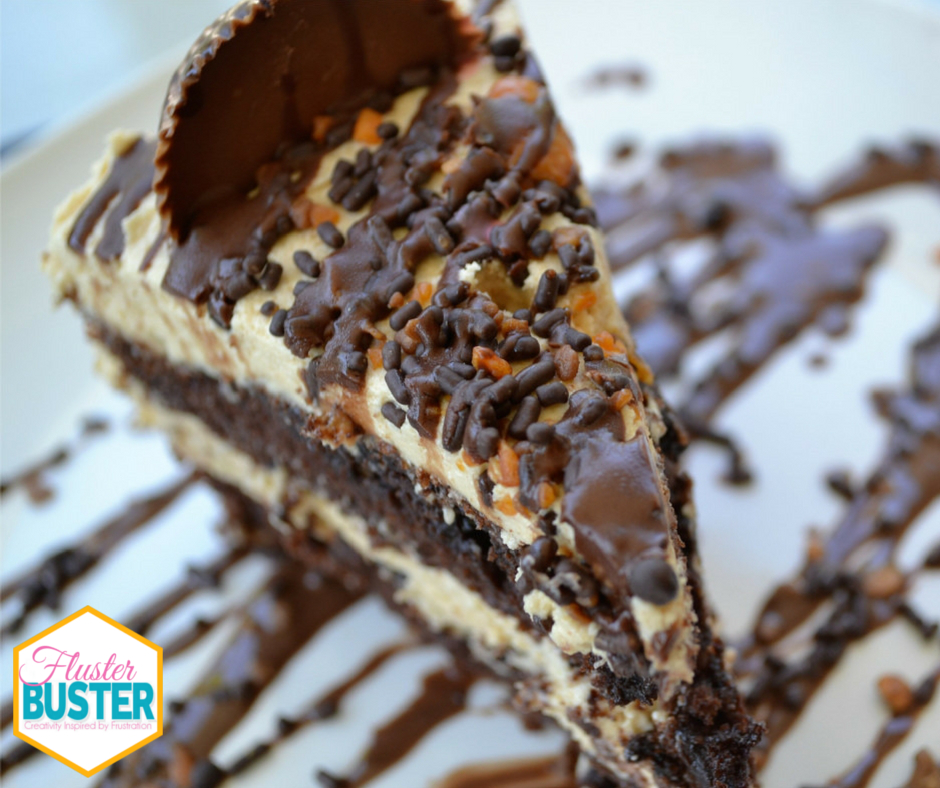 Reese's Layered Cake - A not-to-sweet peanut butter frosting sandwiched between dense fudge brownies, topped with nuts, candy and chocolate.