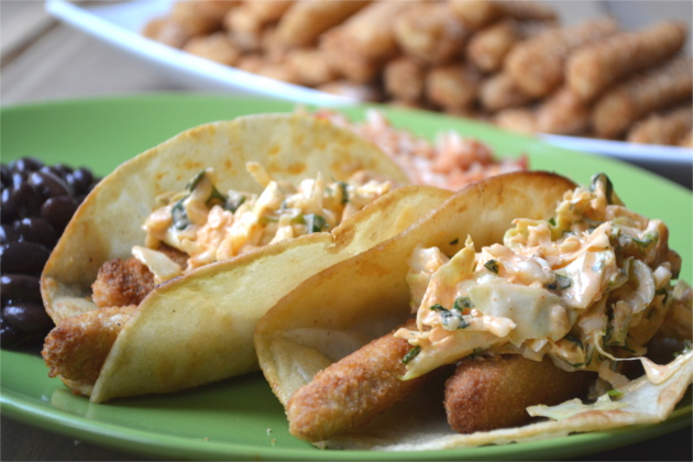 Simple Fish Tacos - crunchy fish sticks wrapped in a lightly fried corn tortilla and topped with a tangy Mexican coleslaw.