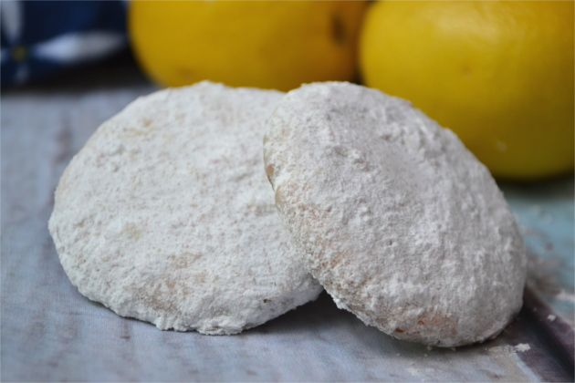 Pink Lemonade Cookies - Zesty lemon cookies covered in a sweet lemon powder create the most intense, delicious lemon flavor. A simple recipe that the lemon lovers in your life are going to go crazy over.