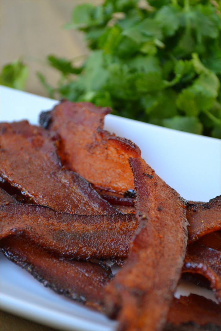 Simple Spicy Mexican Style Bacon Recipe - Thick smokey bacon flavored with a spicy and slightly sweet coating then cooked to crispy perfection in the oven.