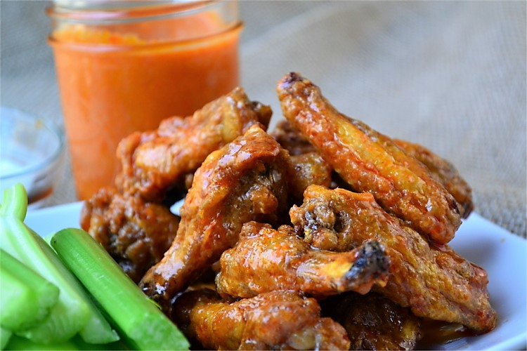 Simple Buffalo Sauce - A simple sauce that is slightly spicy, with a little heat and a nice buttery texture. This buffalo sauce is a milder and more sumptuous form of hot sauce and tastes amazing smothered over chicken wings or used to replace traditional hot sauce.
